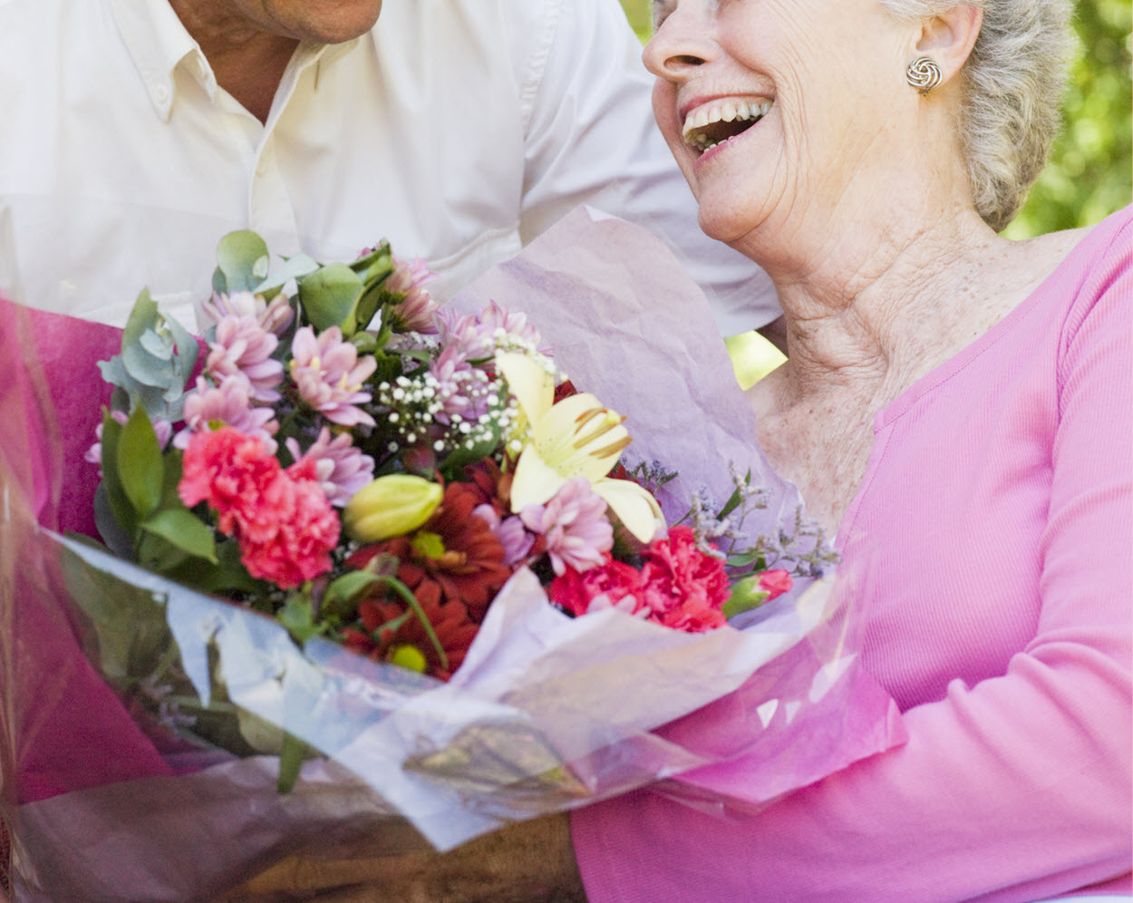 old couple with flowers