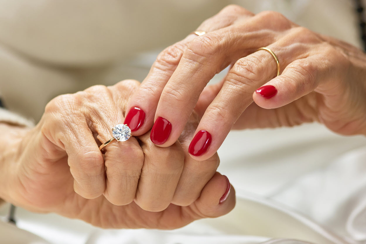old lady fingers with diamond ring