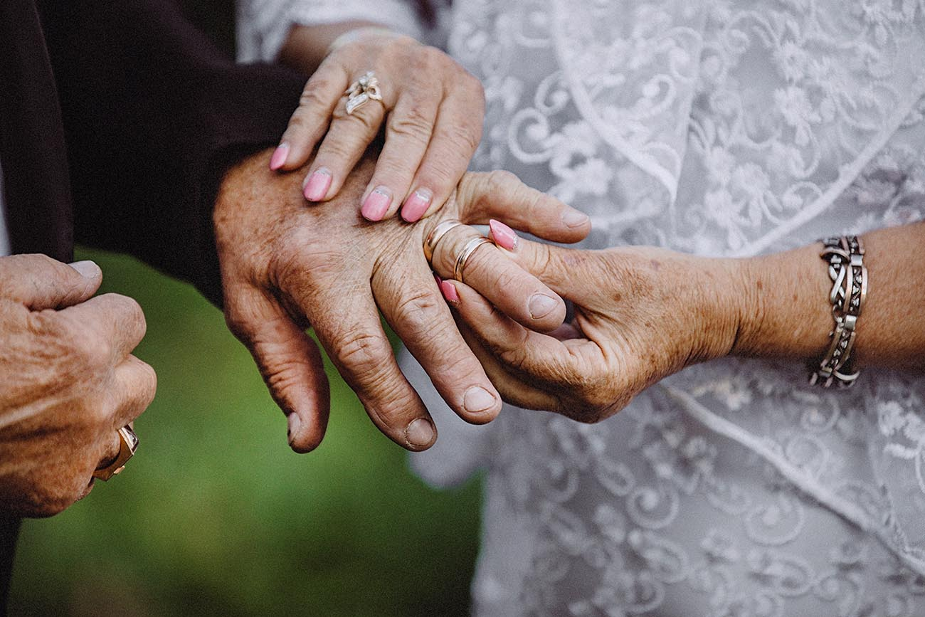 old couple placing ring