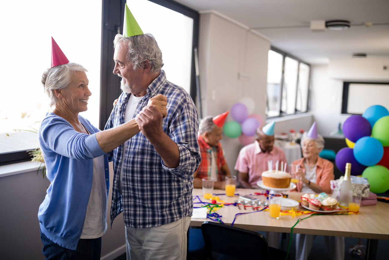 Seniors dancing at a party.